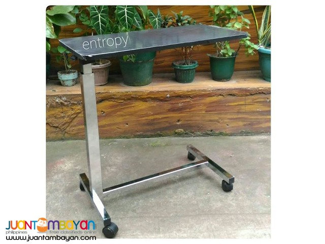 Overbed table with stand and wheels